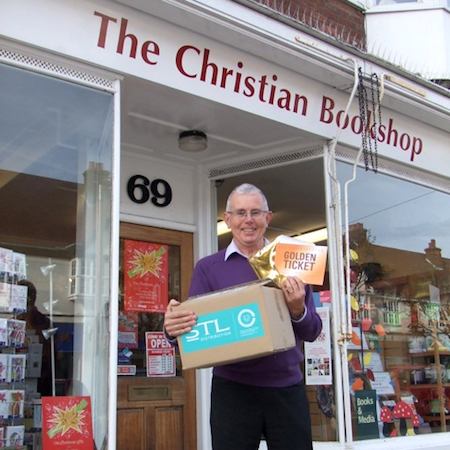 Mike Foster, Acting Manager at Letchworth Christian Bookshop, with the Golden Ticket