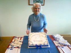 Mary Bartholomew with the Good Bookstall's 10th Anniversary Cake