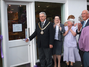 The Mayor of Macclesfield snips the ribbon for the Hope Centre's official opening