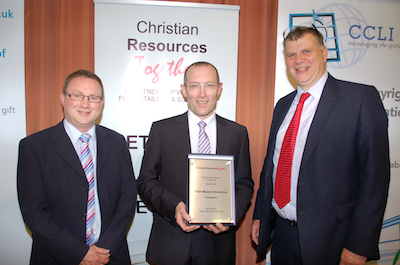 Group Retail Shop of the Year: Jim Mckee (centre) receives the award on behalf of FM Portadown